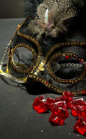 venician: Gold and Black Mask with Red Rubies Stock Photo
