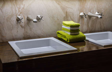 Luxury Double  Bathroom Sink with Green & White Tiles in the Centre photo