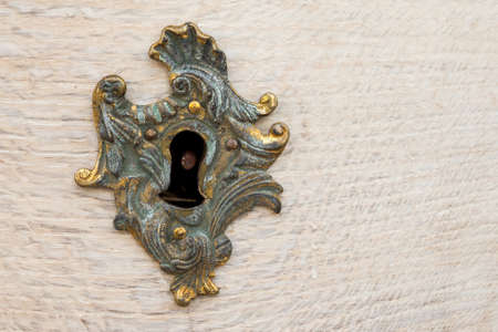centred: Ornate Gold Lock in Wood