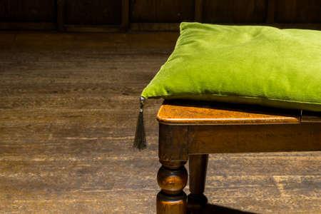 floorboards: Velvet Emerald Green Cushion on Ornate Wooden Chair