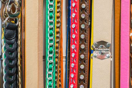 Collection of Colorful Belts on Rack (No Brand Names) photo