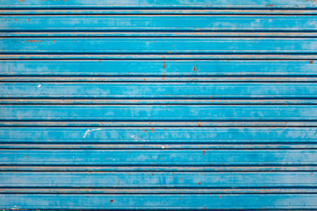 Old and Rusty Blue Roller Security Shutters photo