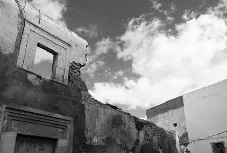 Derelict Buildings with Window, Sky and Clouds Stock Photo
