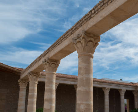 stonemasonry: Roman Colums in Villa with Blue SKy and White Clouds