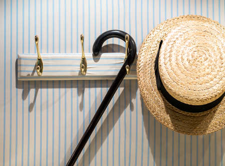 boater: Straw Boater Hat on Hook in Cloakroom
