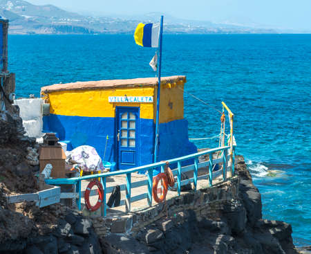 fishing hut: Colorful Painted Fishing Hut in Harbor