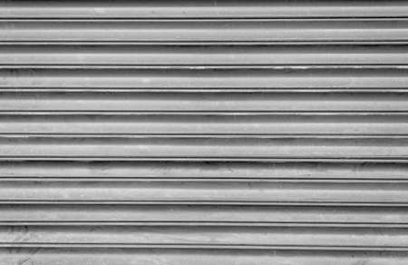 security shutters: Grey Dusty and Dirty Closed Security Shutters Stock Photo