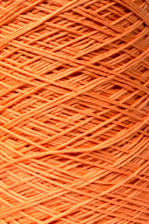 darn: Close Up of Orange Thread on Spindle
