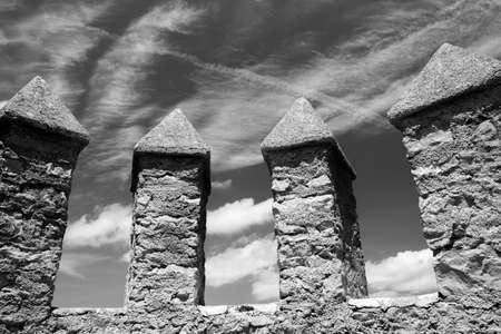 parapet wall: Fortified Castle Ramparts with Sky and Clouds Editorial