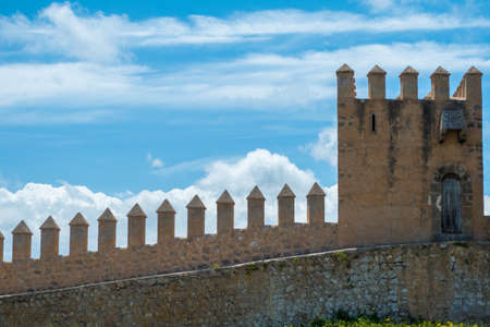 parapet wall: Pointed and Strong Dramatic Castle Defenses with Cloudy Sky