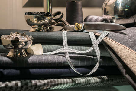 tailored: Still Life of Tailors Shop with Tools of the Trade and Cloth Stock Photo