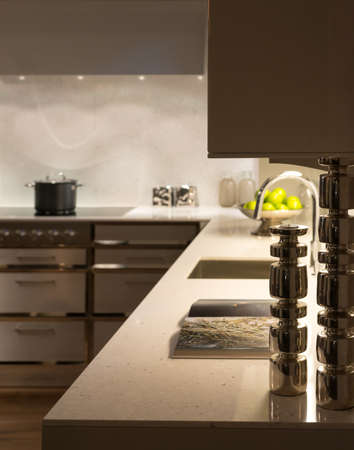 contemporary kitchen: Stylish Modern Contemporary Kitchen with Underlighting and Silver Candle Sticks