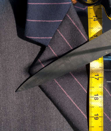 suit man: Pin-Striped Business Suit with Yellow Tape Measure and Scissors
