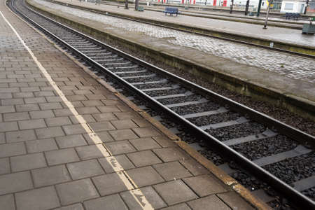 grimy: DIrty and Grimy Railway Platform and Train Tracks Stock Photo