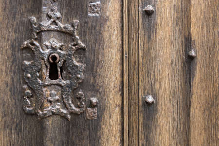 antique keyhole: Old Rusty Keyhole with Antique Wooden Door Stock Photo