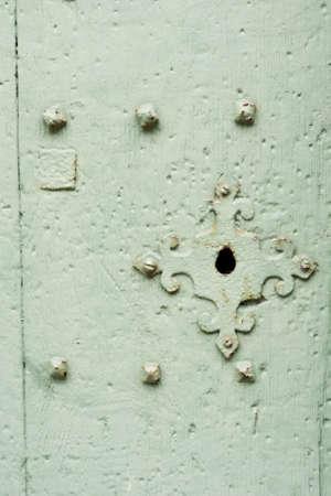 Solid Green Wooden Painted Door and Metallic Lock photo