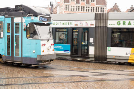 cobbled: March 2015- Ghent, Belgium - Moving Tram on Cobbled Street . Editorial