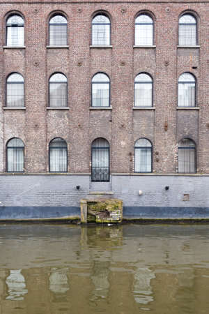 gent: Ghent, Belgium , 4 April 2015 - Charming Hotel Facade looking out over canal water