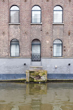Ghent, Belgium , 4 April 2015 - Charming Hotel Facade looking out over canal water