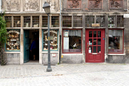 dickensian: GHENT, BELGIUM - CIRCA APRIL 2015 : Ornate and Beautiful Vintage Shop Front in European Town of Ghent with Crooked Lamppost