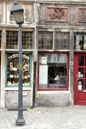 GHENT, BELGIUM - CIRCA APRIL 2015 : Ornate and Beautiful Vintage Shop Front in European Town of Ghent with Crooked Lamppost