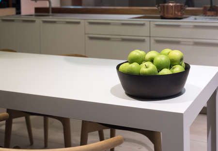 Clean and Modern Table in Stylish Kitchen with Bowl of Apples