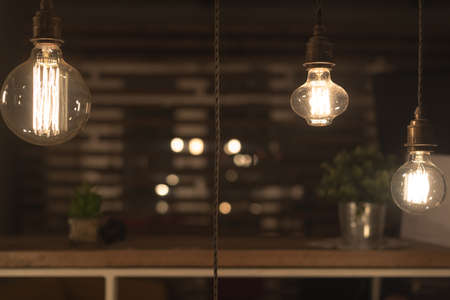 Low Watt Tungsten Bulbs Hanging from Cord Stock Photo