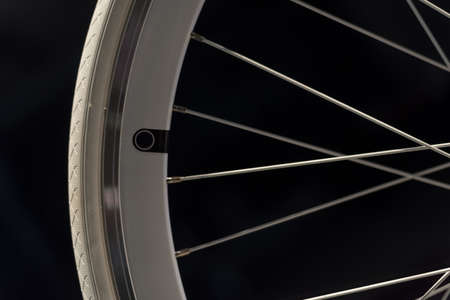 White Bicycle Wheel, Rim, Tyre and Spokes on Black Background photo