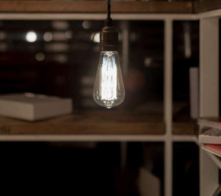 watt: Low Watt Tungsten Bulbs Hanging from Cord Stock Photo