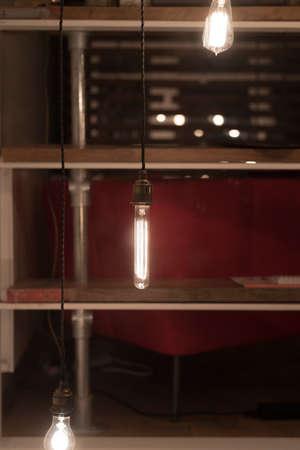 tungsten: Low Watt Tungsten Bulbs Hanging from Cord Stock Photo