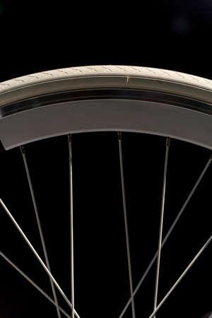 rim: White Bicycle Wheel, Rim, Tyre and Spokes on Black Background
