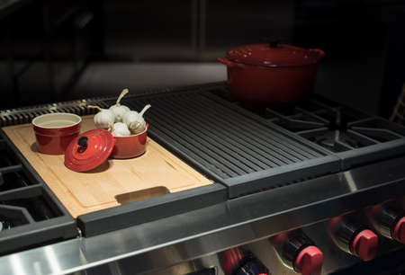 hob: Modern and Contemporary Gas Hob with Garlic in Pot