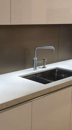 contemporary kitchen: Clean and Contemporary Kitchen Worktop with Steel Faucet and Sink