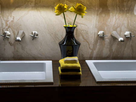 double sink: Luxury Double  Bathroom Sink with Green & White with Flowers and Towels Stock Photo