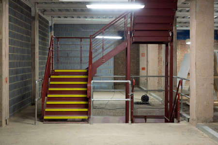 industry inside: Empty and Bare Building Interior with Materials and Structure Exposed Stock Photo