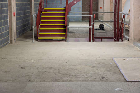 metallic stairs: Empty and Bare Building Interior with Materials and Structure Exposed Stock Photo
