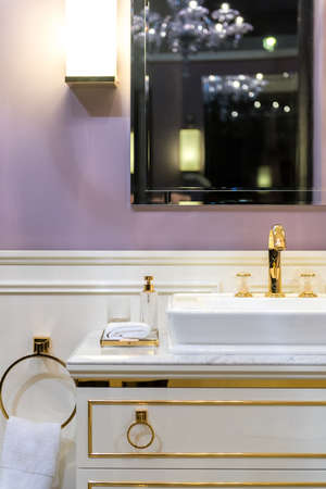 ostentatious: Beautifully Bright Restroom with Gold, White and Purple Furnishings