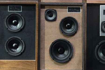speaker system: Old Style Wooden Electronic Music Speakers Stacked Next To Each Other