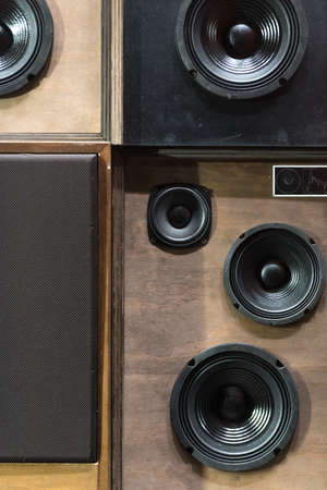 musica electronica: Old Style Wooden Electronic Music Speakers Stacked Next To Each Other