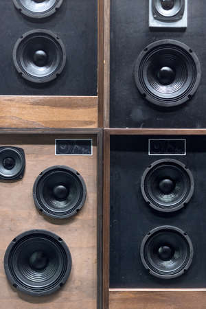 electronic music: Old Style Wooden Electronic Music Speakers Stacked Next To Each Other