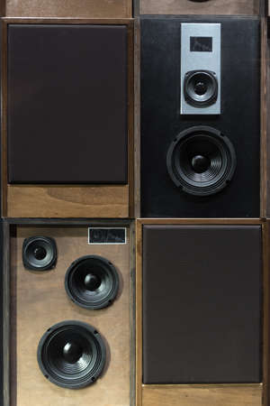 next to each other: Old Style Wooden Electronic Music Speakers Stacked Next To Each Other