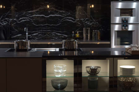 Expensive and Well-Appointment Kitchen with Black Marble