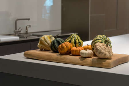 kitchen counter top: Various Autumnal Fall Vegetables on Modern Kitchen Counter Top Stock Photo
