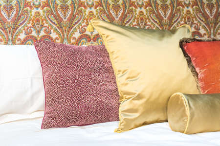 headboard: Luxury and Expensive Bed Pillows with Ornate and Vintage Headboard