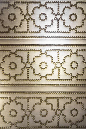 studs: Canvas Textile Material with Brass Studs in Geometric Pattern