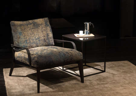 bespoke: Luxury Armchair on Rug with Stylish Bespoke Coffee Table and Cafetiere Stock Photo