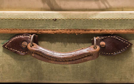 worn: Worn Leather Handle on Old Suitcase Stock Photo