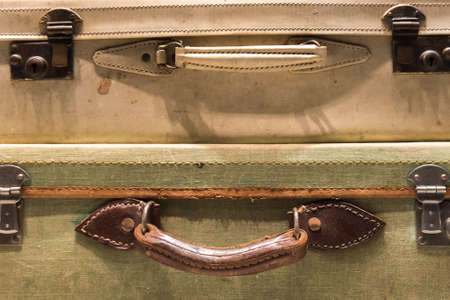 tatty: Worn, Tatty and Used Suitcases Stock Photo