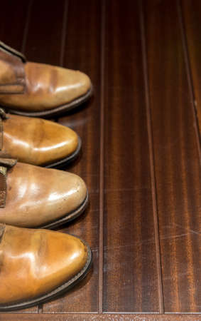 worn: Worn Leather Boots on Polished Wooden Floor