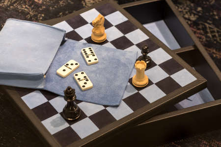 Various Chess Pieces on Checkerboard with Assorted Dominos